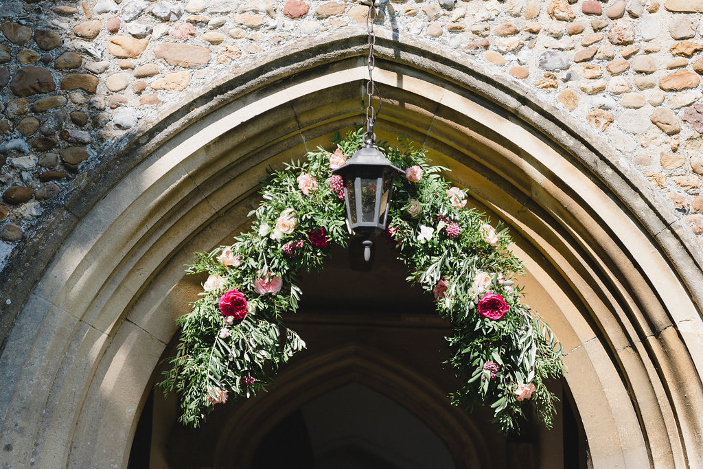floral arch church wedding