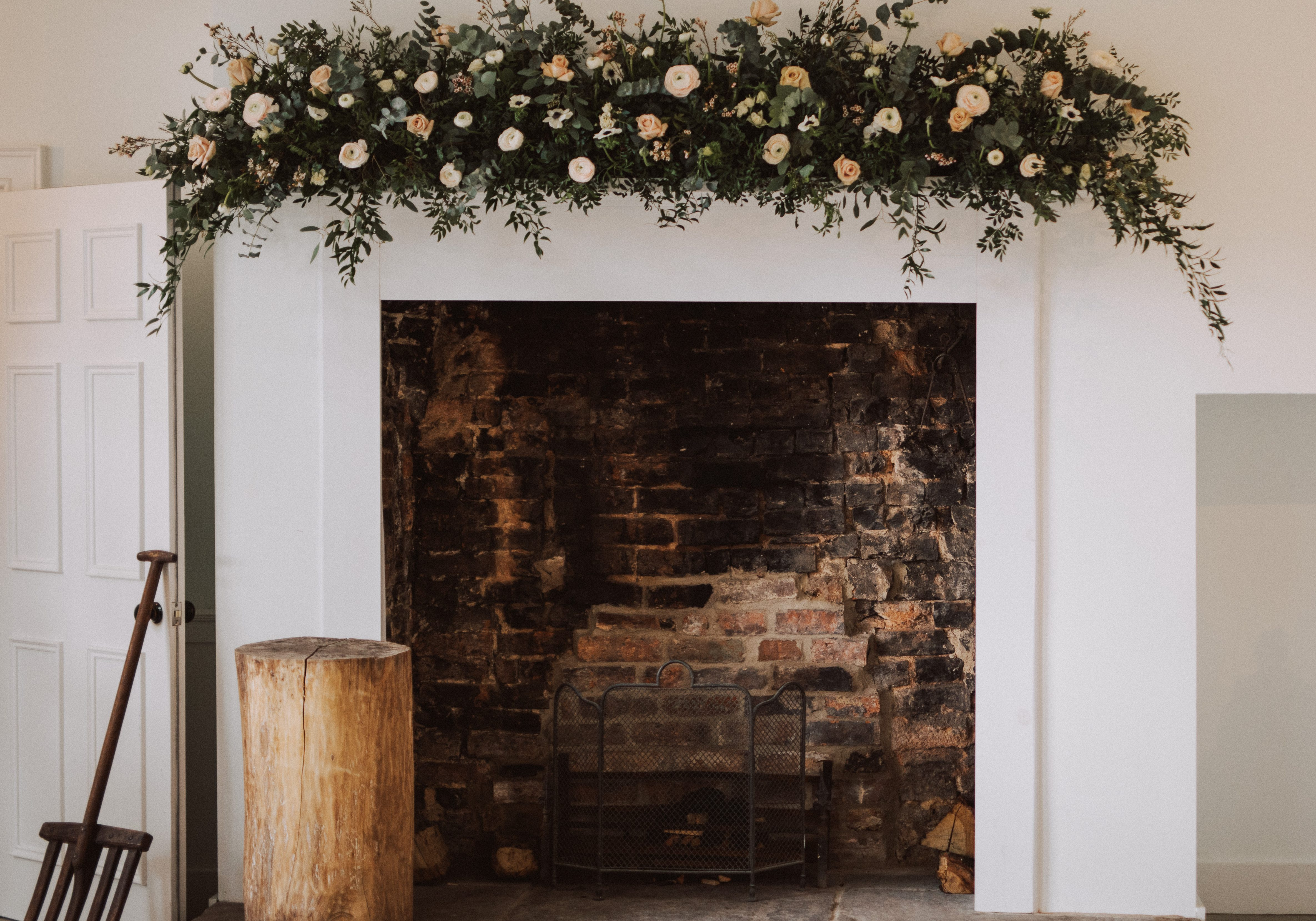 Fireplace floral installation | A luxury winter wedding at Aswarby Rectory, planned and styled by Mirabella Weddings - UK wedding planner
